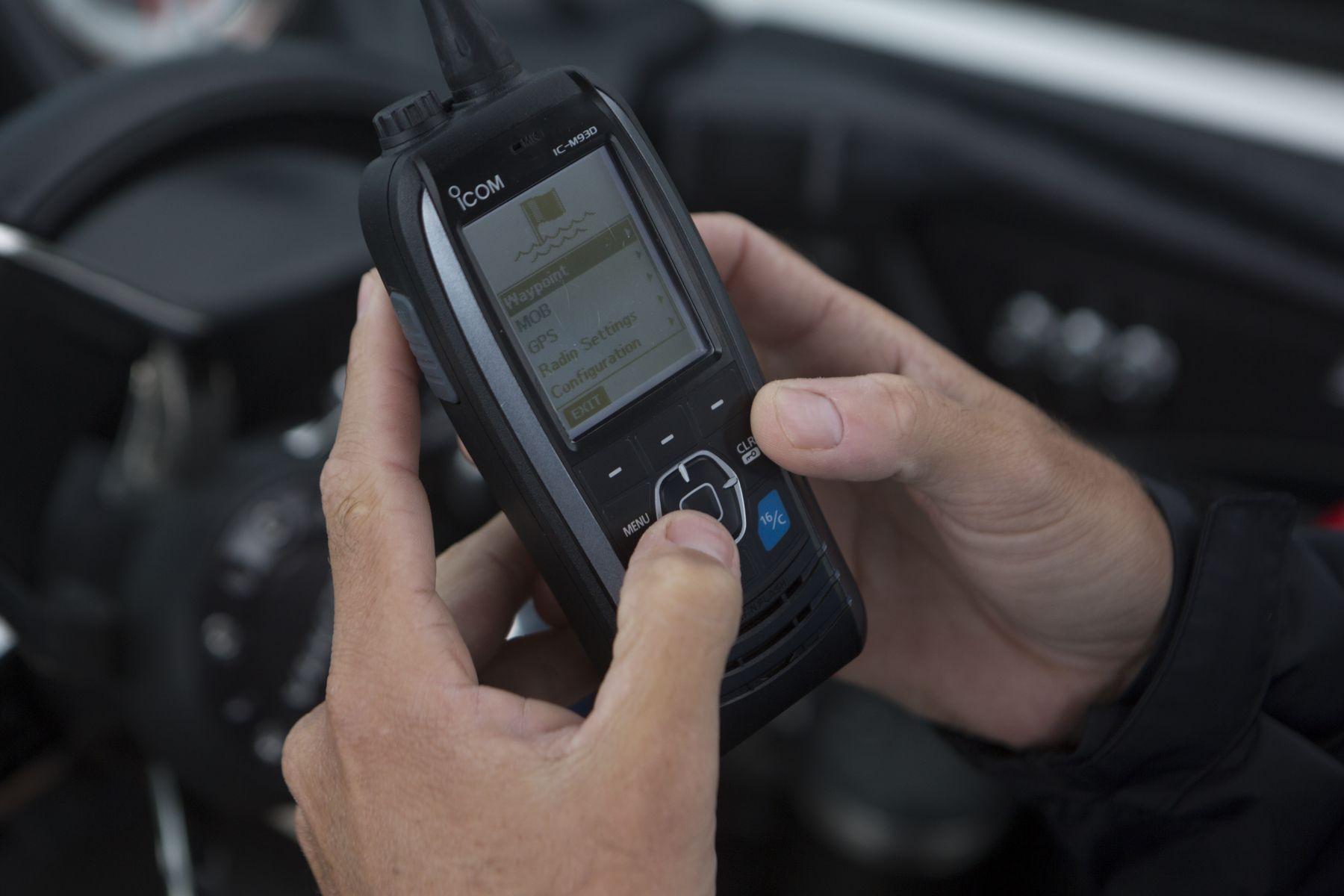 Using a handheld VHF-DSC marine band radio set to channel 16.