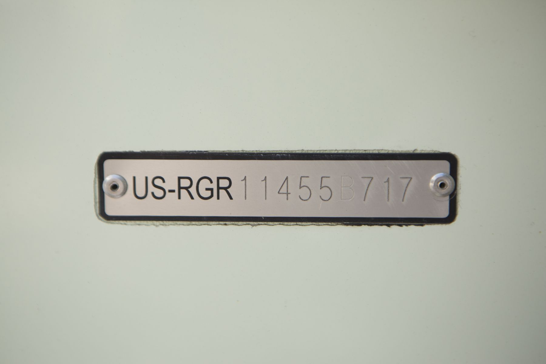 A hull identification number on a watercraft.