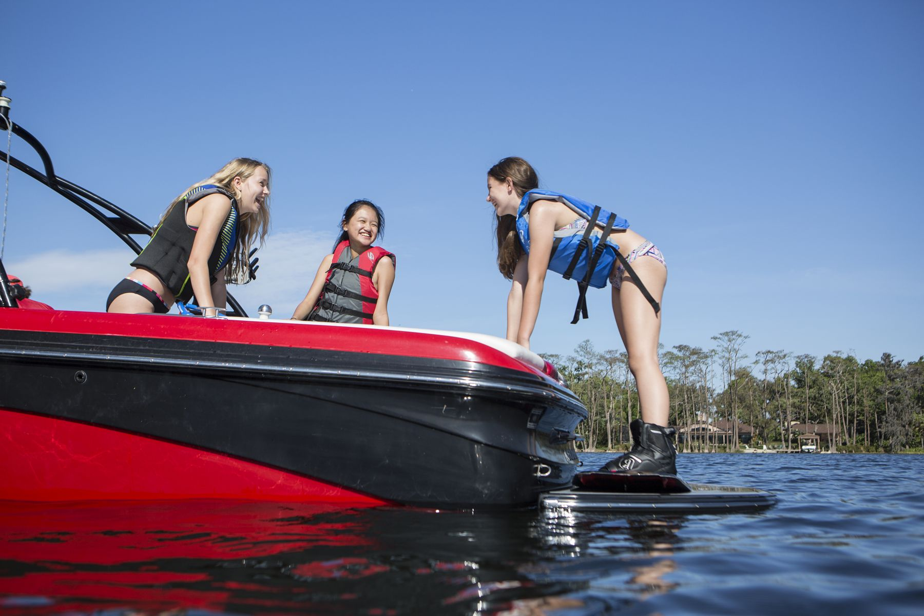 Kids having fun on the water in properly fitting life jackets.