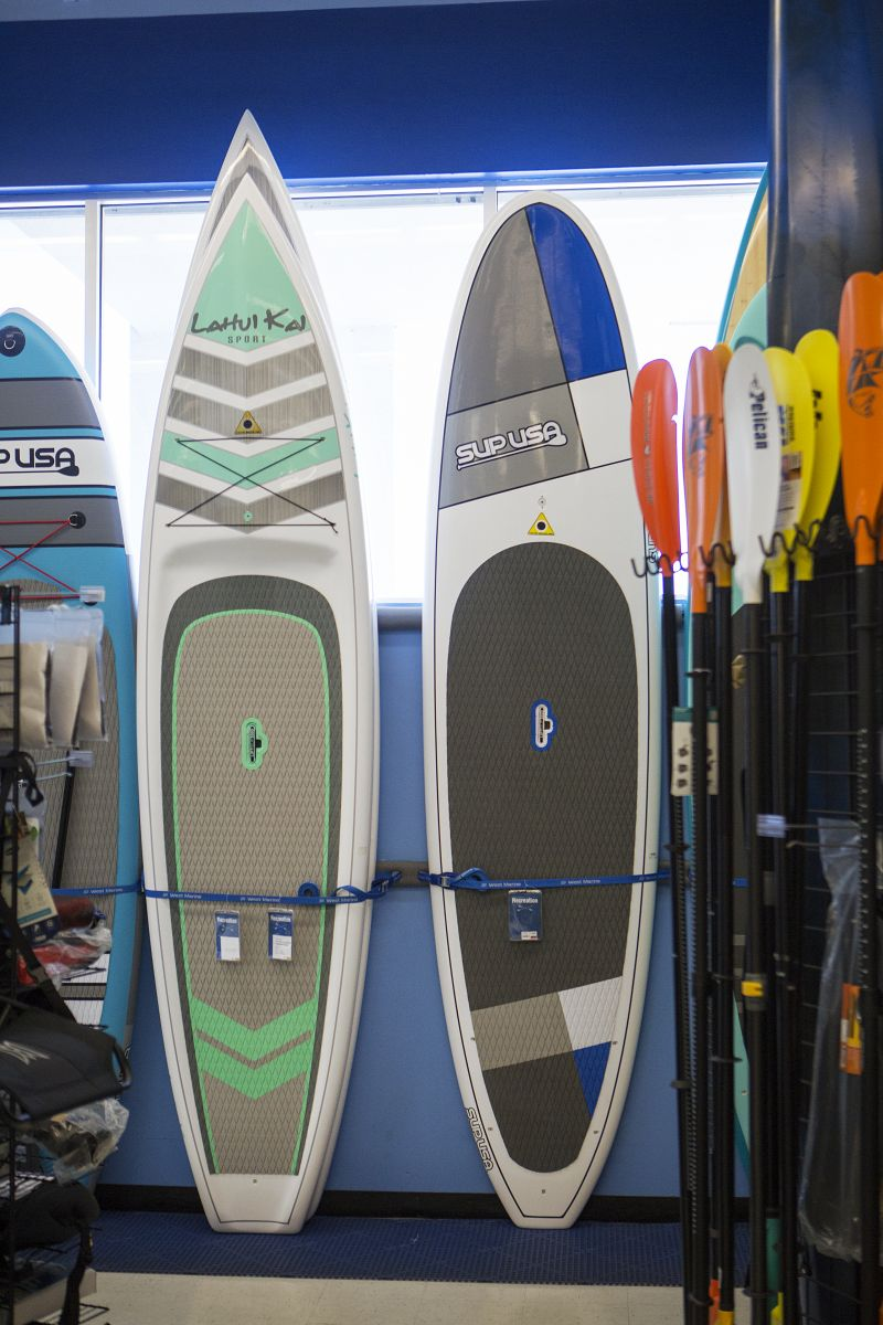 Low cost paddle craft on display in a retail outlet.