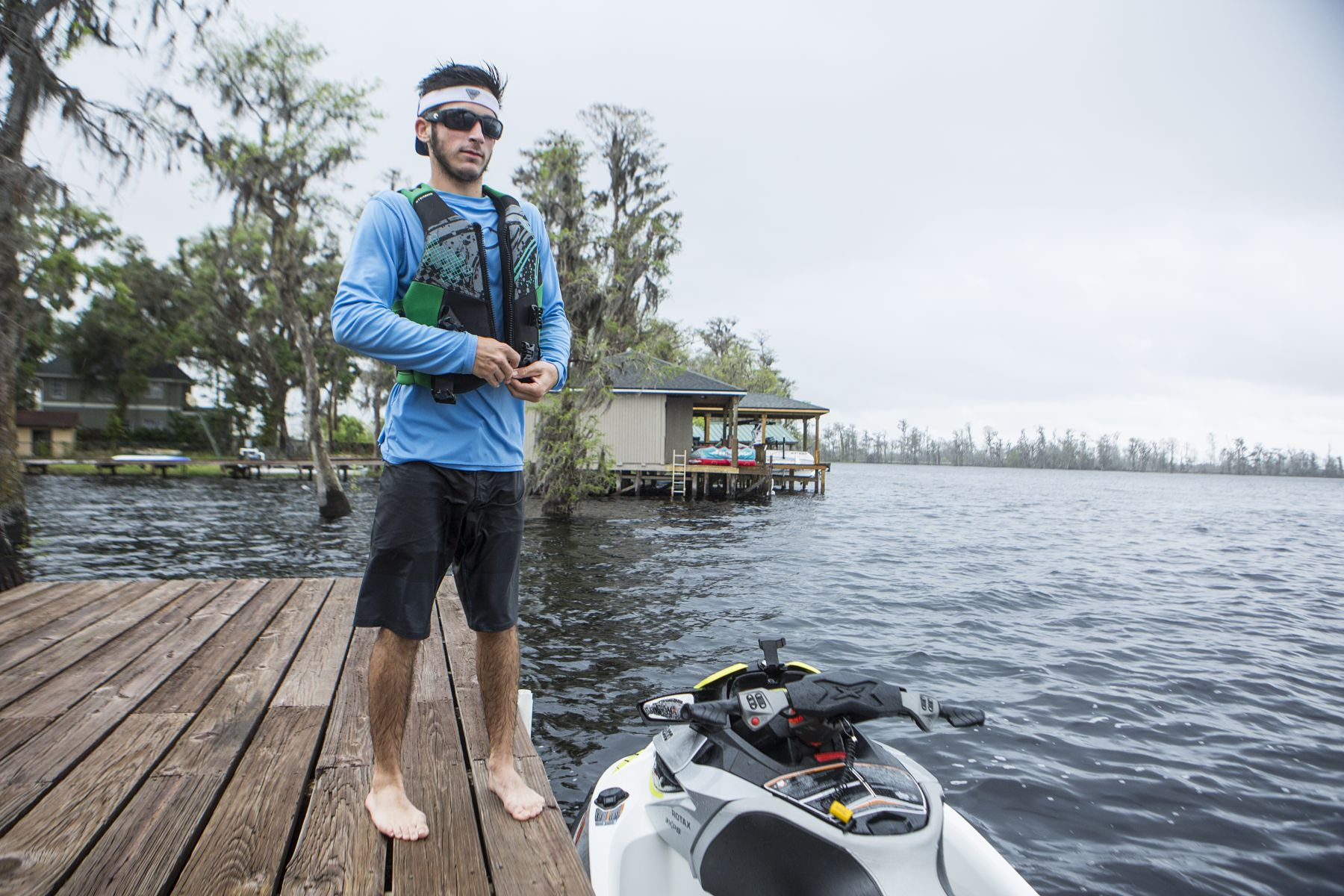 Putting a life jacket on before operating a personal watercraft.