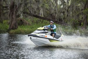 Riding a personal watercraft while wearing a properly fitting life jacket.