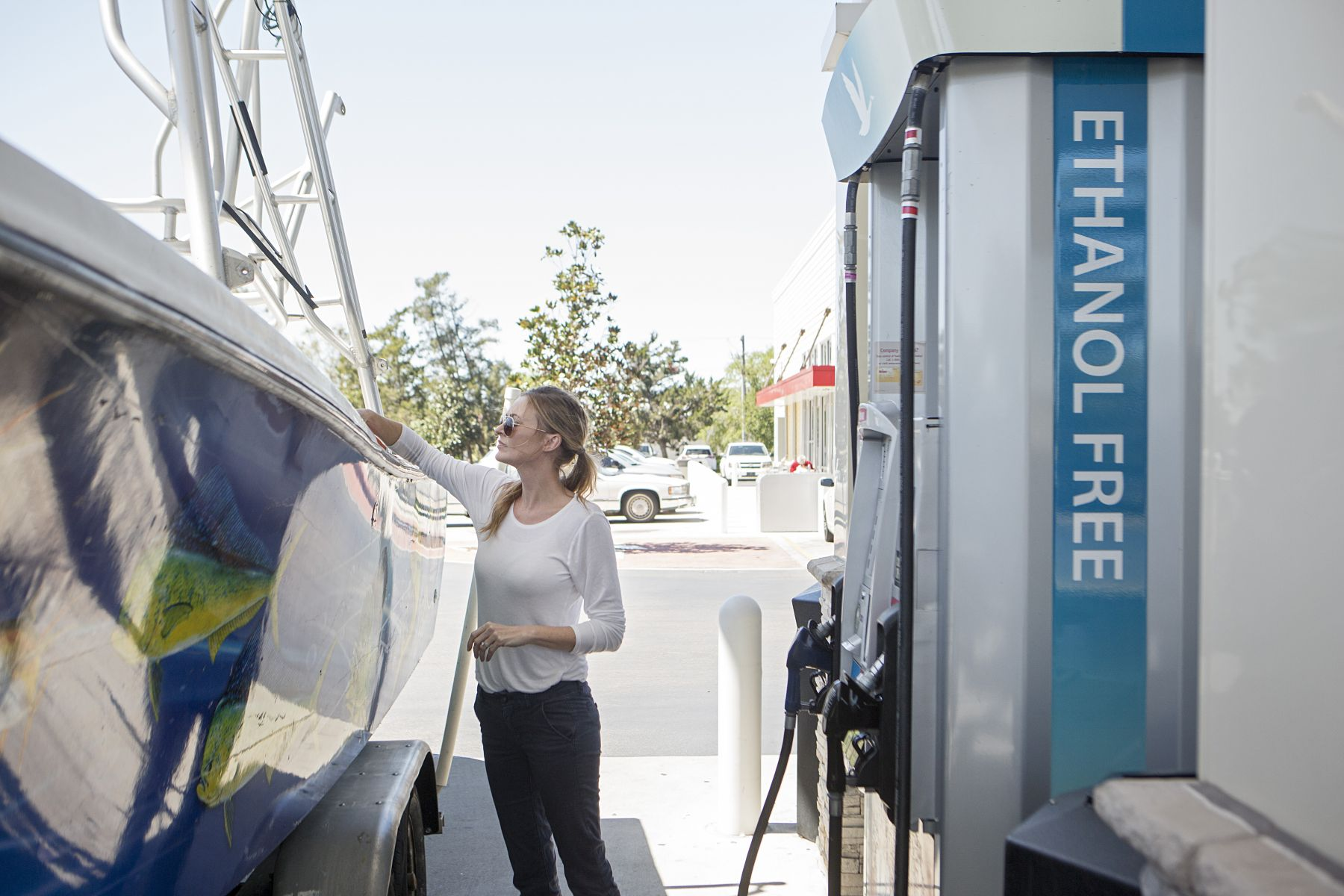 Properly fueling a boat with ethanol free, unleaded gasoline at a land pump.