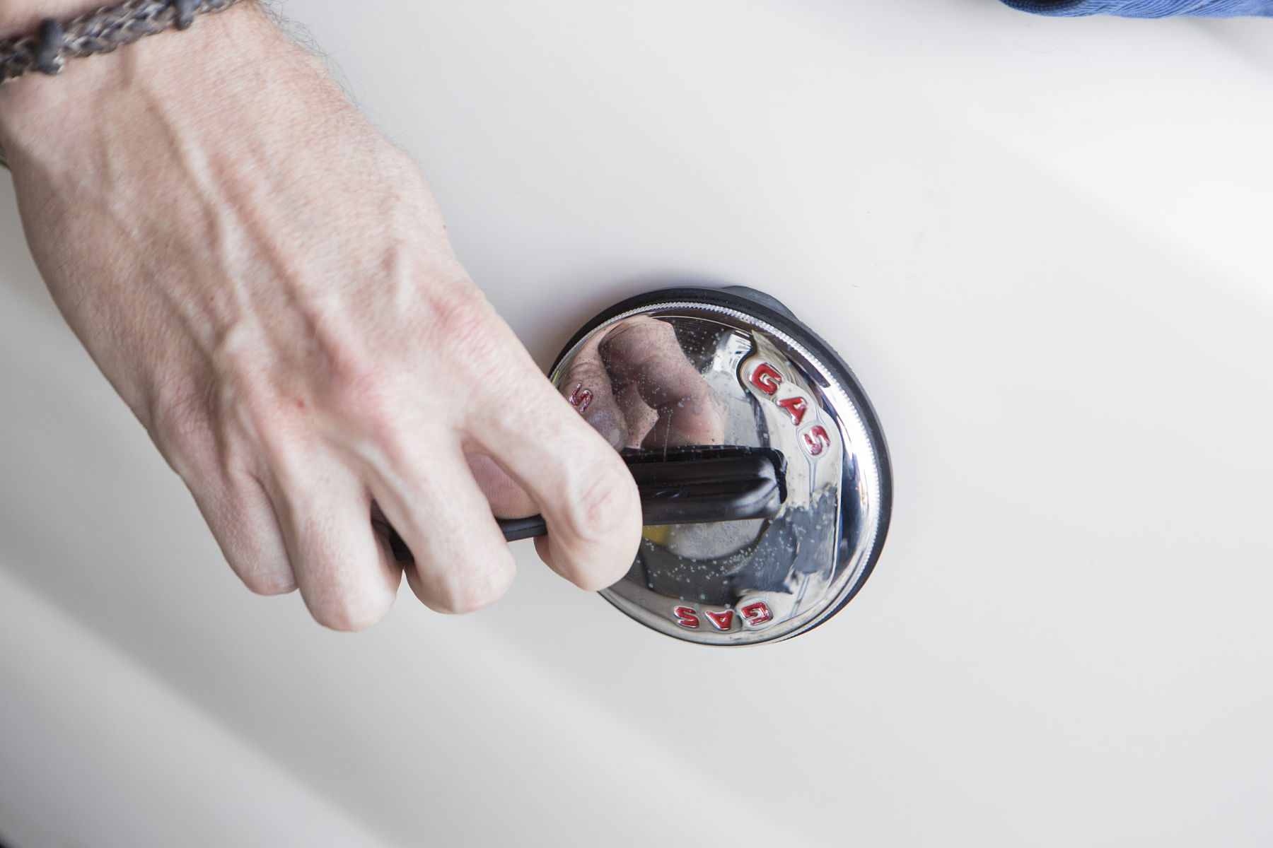 Opening a marine gas cap using a gas cap key.