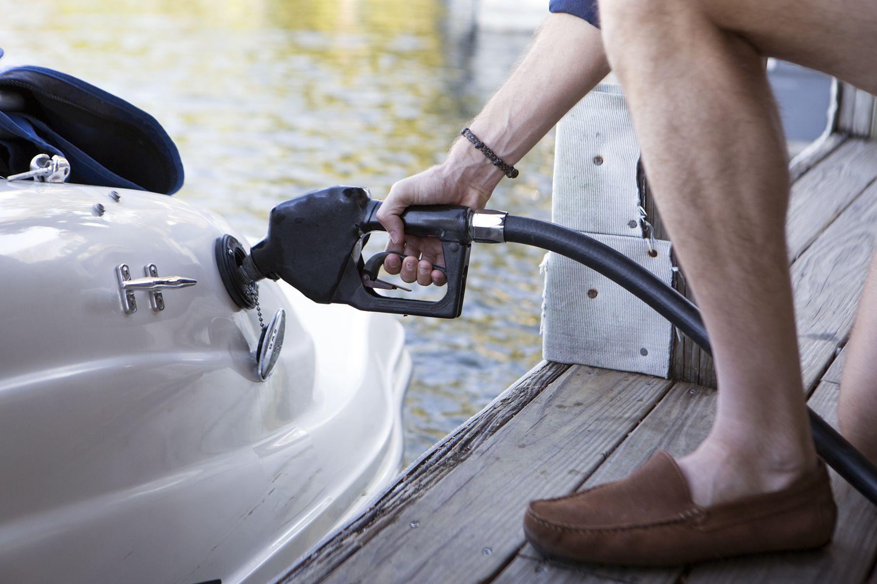 Refueling a boat at a marina pump.