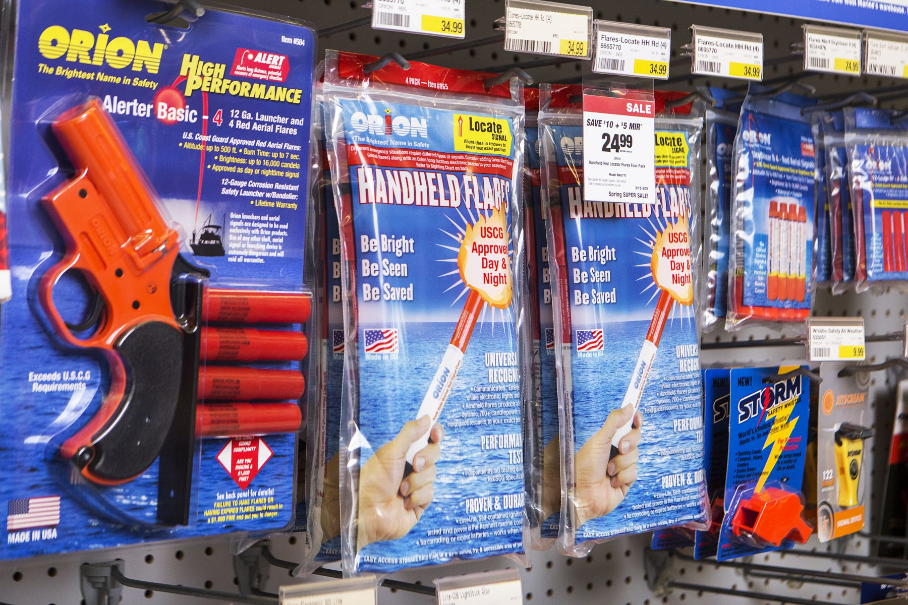 Flares and other safety equipment on the shelves at a retail outlet.