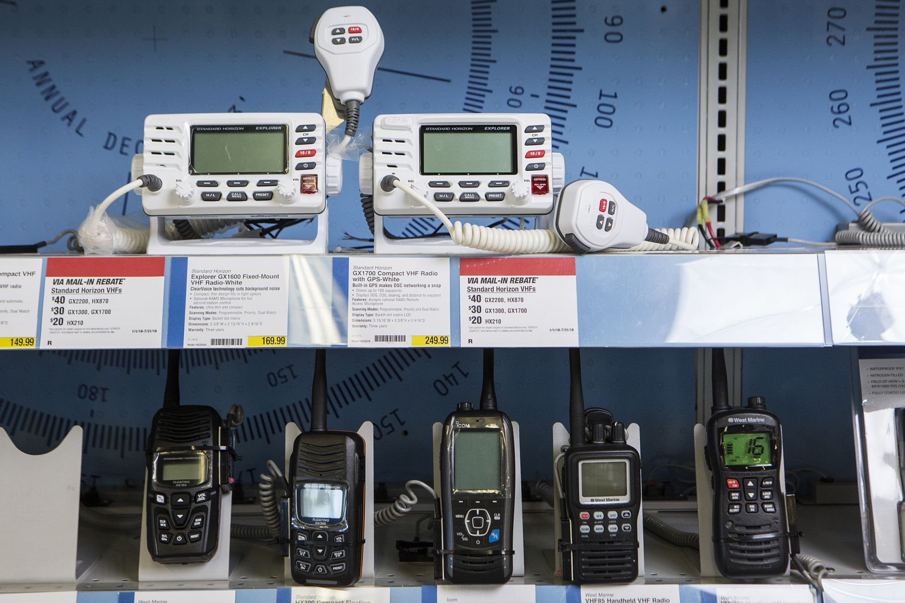 VHF and handheld VHF radios on display at a retail outlet.