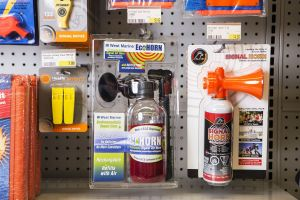 Horns and other safety equipment on the shelves at a retail outlet.