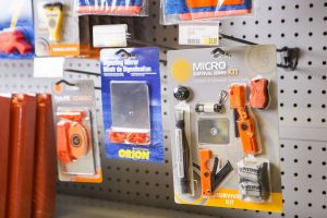 Signaling mirrors and other safety equipment on the shelves at a retail outlet.