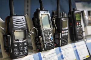 Handheld VHF radios on display at a retail outlet.