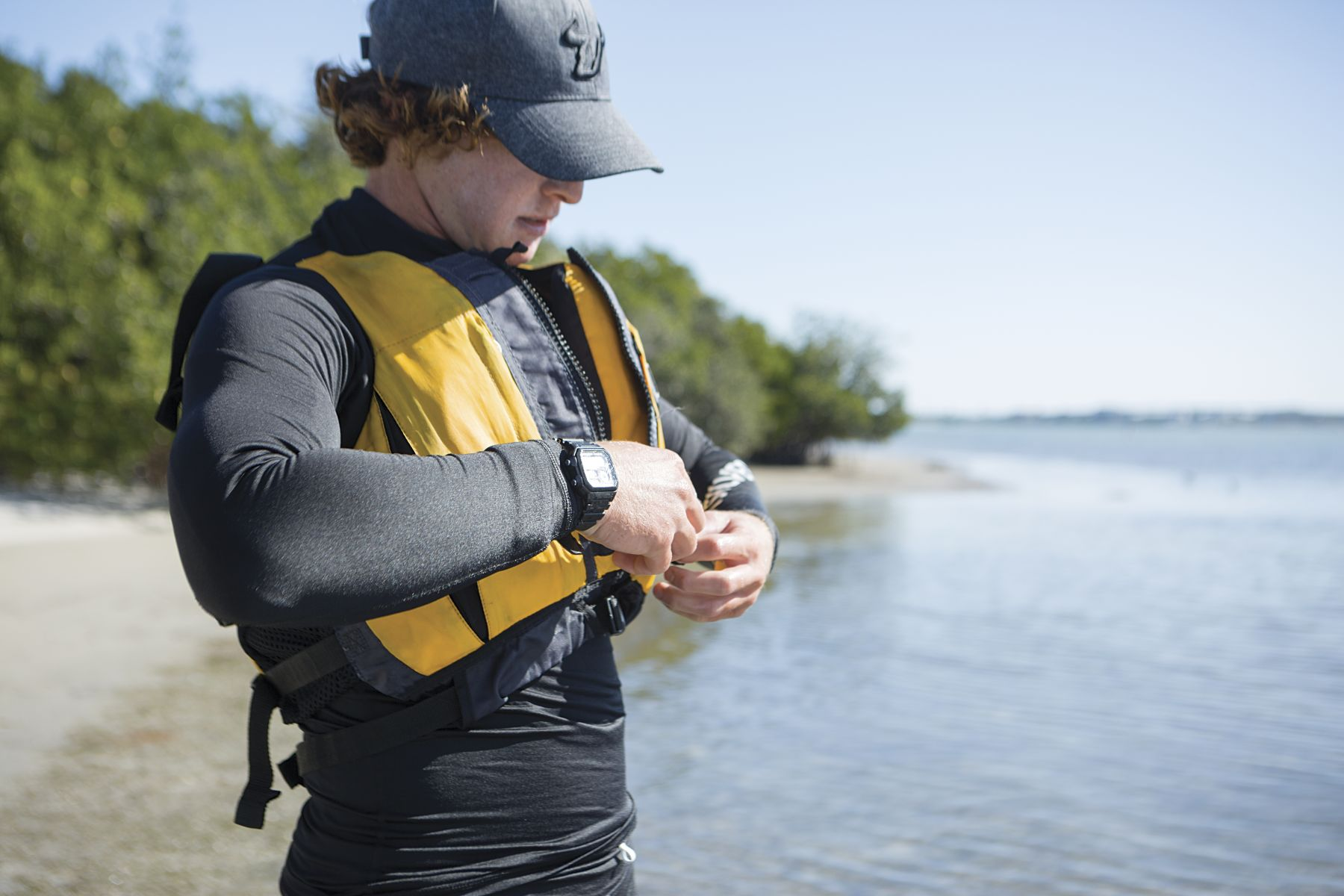 Putting on a properly fitting life vest before sailing in the Sand Key inlet in Clearwater Beach.