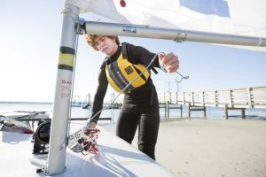 Rigging the sail while wearing a properly fitting life vest in the Sand Key inlet in Clearwater Beach.