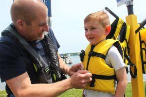 STF-Dad-put-life-jacket-on-kid