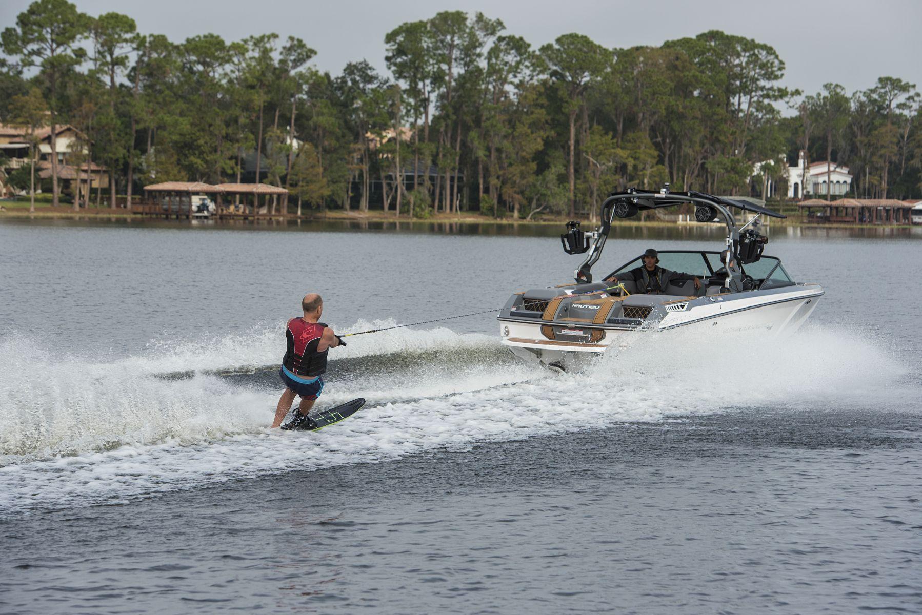 Water skiing behind a water ski boat on Lake Sheen in Orlando, Florida.